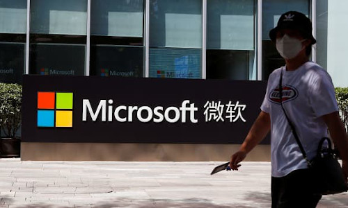 A person walks past a Microsoft sign at the company's office in Beijing, China